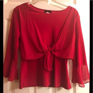 Adorable red top with flare sleeves